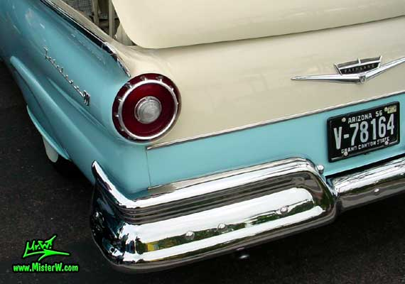Photo of a white & blue 1957 Ford Fairlane Retractable Hardtop / Convertible at the Scottsdale Pavilions Classic Car Show in Arizona. Tail Light of a 1957 Ford Retractable