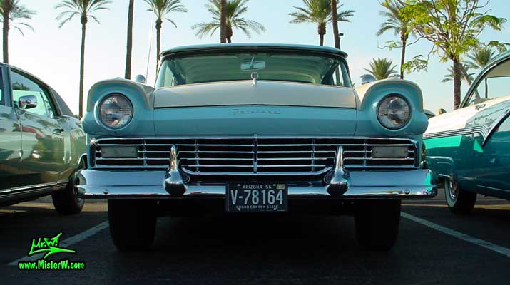 Photo of a white & blue 1957 Ford Fairlane Retractable Hardtop / Convertible at the Scottsdale Pavilions Classic Car Show in Arizona. Photo of a 1957 Ford Chrome Grill