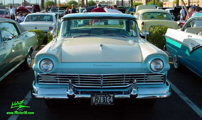 Photo of a white & blue 1957 Ford Fairlane Retractable Hardtop / Convertible at the Scottsdale Pavilions Classic Car Show in Arizona. Frontview of a 1957 Ford Fair Line with closed Retractable Top
