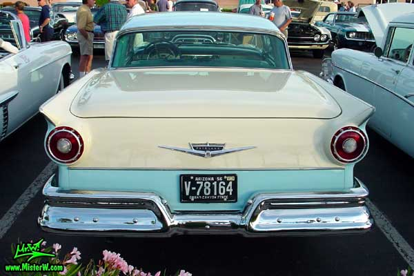 Photo of a white & blue 1957 Ford Fairlane Retractable Hardtop / Convertible at the Scottsdale Pavilions Classic Car Show in Arizona. Rearview of a 1957 Ford Fair Line with closed Retractable Top