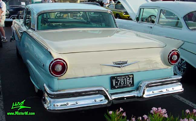 Photo of a white & blue 1957 Ford Fairlane Retractable Hardtop / Convertible at the Scottsdale Pavilions Classic Car Show in Arizona. Tail Fins of a 1957 Ford Fair Line with closed Retractable Hardtop
