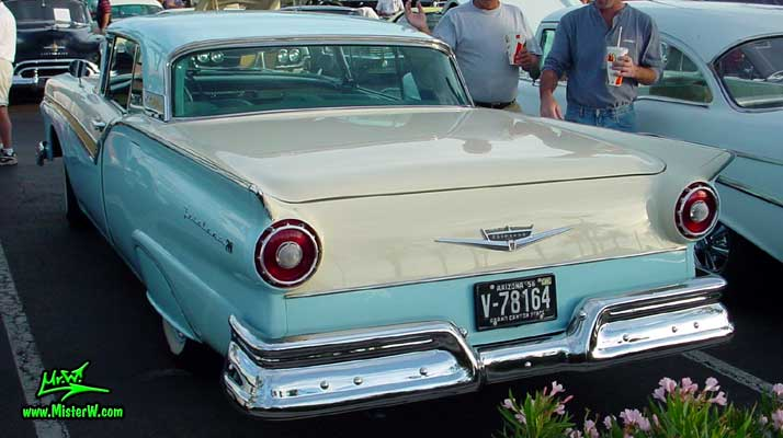 Photo of a white & blue 1957 Ford Fairlane Retractable Hardtop / Convertible at the Scottsdale Pavilions Classic Car Show in Arizona. 1957 Ford Fins