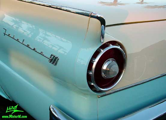 Photo of a white & blue 1957 Ford Fairlane Retractable Hardtop / Convertible at the Scottsdale Pavilions Classic Car Show in Arizona. Fin of a 1957 Ford