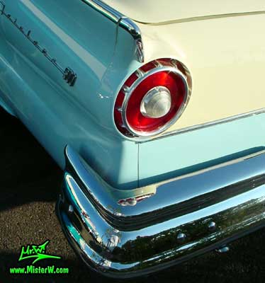 Photo of a white & blue 1957 Ford Fairlane Retractable Hardtop / Convertible at the Scottsdale Pavilions Classic Car Show in Arizona. Tail Light of a 1957 Ford Fairlane with Retractable Top