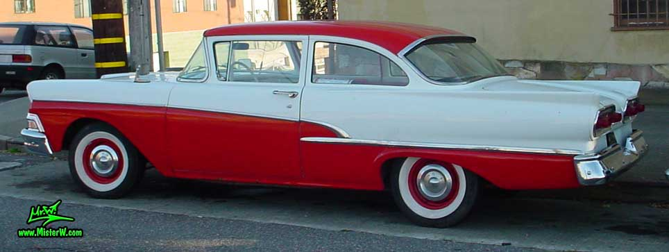 Photo of a white & red 1958 Ford 2 Door Hardtop Coupe in San Francisco. Sideview of a 1958 Ford Coupe