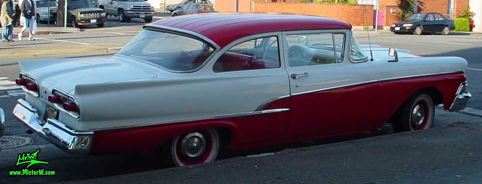 Photo of a white & red 1958 Ford 2 Door Hardtop Coupe in San Francisco. Rearview of a 1958 Ford Coupe