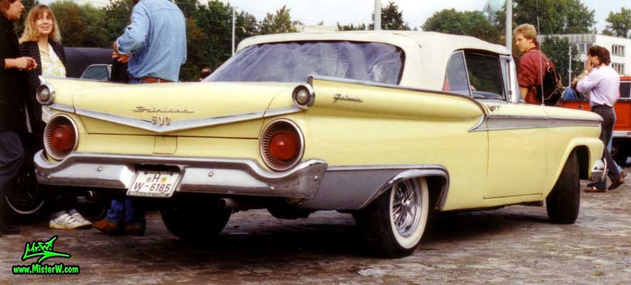 Photo of a yellow 1959 Ford Fairlane Convertible at a classic car meeting in Germany. 1959 Ford Fairlane Convertible Rearview