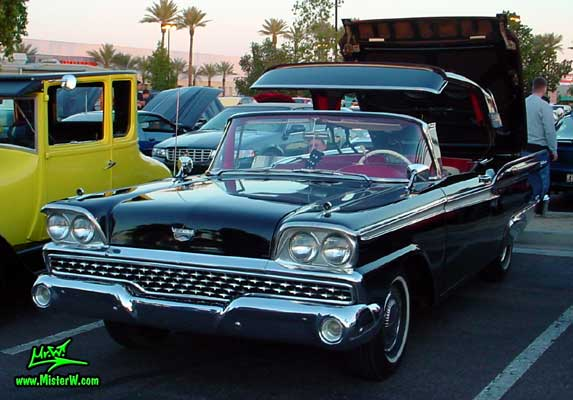 Photo of a black 1959 Ford Fairlane Retractable Hardtop / Convertible at the Scottsdale Pavilions Classic Car Show in Arizona. 1959 Ford Retractable