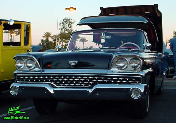 Photo of a black 1959 Ford Fairlane Retractable Hardtop / Convertible at the Scottsdale Pavilions Classic Car Show in Arizona. 1959 Ford Retractable Hardtop