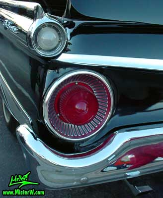 Photo of a black 1959 Ford Fairlane Retractable Hardtop / Convertible at the Scottsdale Pavilions Classic Car Show in Arizona. 1959 Ford Tail Light