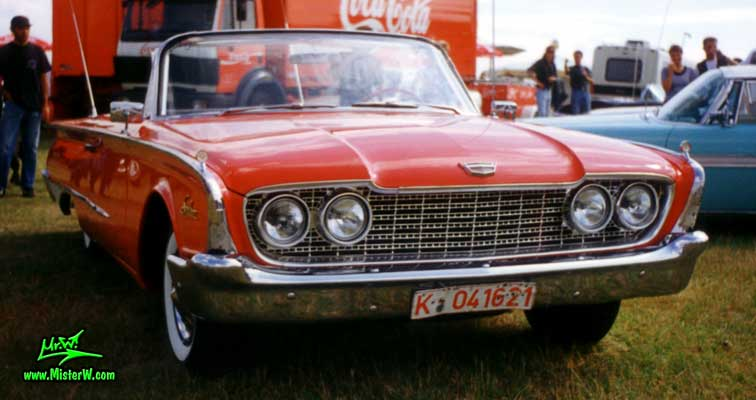 Photo of a red 1960 Ford Sunliner Convertible at a classic car meeting in Köln Chorweiler (Cologne), Germany. 1960 Ford Sunliner Convertible Frontview