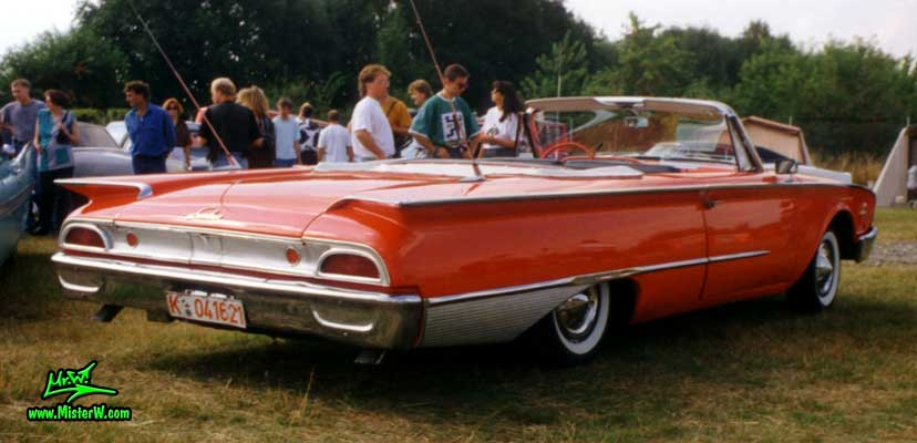 Photo of a red 1960 Ford Sunliner Convertible at a classic car meeting in K�ln Chorweiler (Cologne), Germany. 1960 Ford Sunliner Convertible Tail Fins