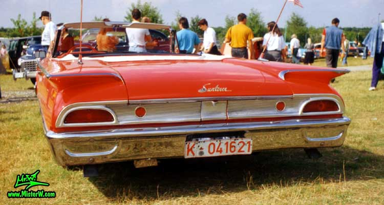 Photo of a red 1960 Ford Sunliner Convertible at a classic car meeting in Köln Chorweiler (Cologne), Germany. 1960 Ford Sunliner Convertible Rearview