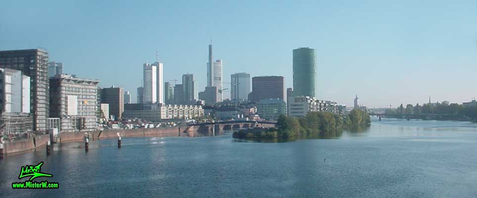 Photo of the downtown Frankfurt high rise skyscraper skyline & the river Main, taken from a ICE train (Intercity Express) in summer 2003 Downtown Frankfurt am Main