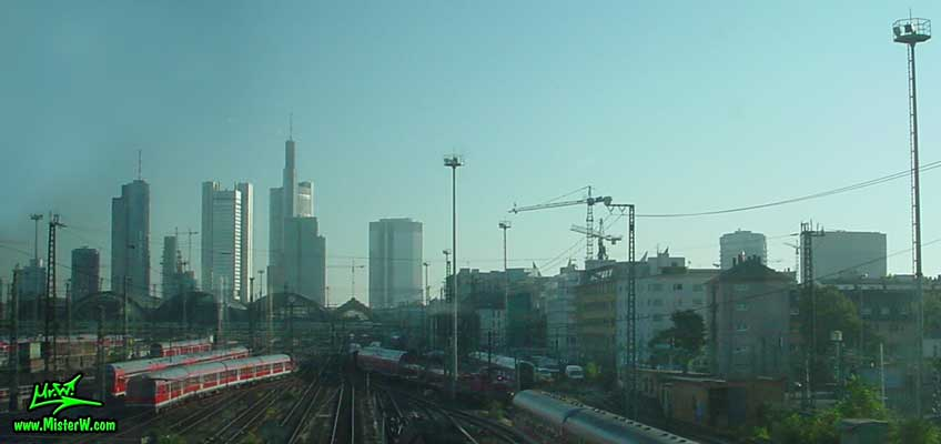 Photo of the Hauptbahnhof & the high rise skyscrapers in downtown Frankfurt, taken from a ICE train (Intercity Express) in summer 2003<BR>Hauptbahnhof of short Hbf is the Main Central Train Station in down town Frankfurt Hauptbahnhof, Trains & skyscrapers in Frankfurt