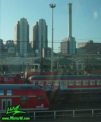 Photo of passenger Trains close to the Hauptbahnhof in downtown Frankfurt, taken from a ICE train (Intercity Express) in summer 2003 Train Graffiti Panel in Frankfurt am Main