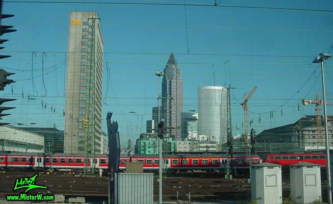 Photo of passenger Trains & high rise skyscraper buildings in downtown Frankfurt, taken from a ICE train Trains & Skyscrapers in Frankfurt am Main