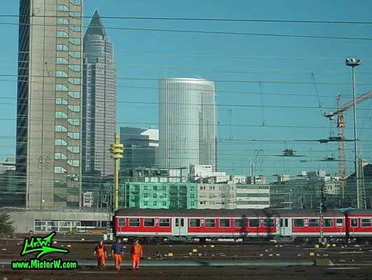 Photo of train workers in front of the MesseTurm in downtown Frankfurt, taken from a ICE train Train Workers in Downtown Frankfurt am Main