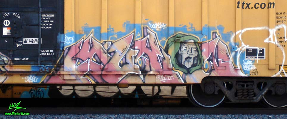 Photo of a Freight Train with Yukon Graffiti