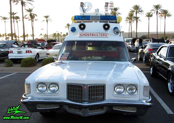 Photo of a red & white Pontiac Ambulance turned into ECTO-AZ the Arizona Ghostbusters Ectomobile at the Scottsdale Pavilions Classic Car Show in Arizona. Arizona Ghostbuster Ectomobile ECTO-AZ