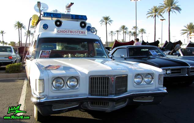 Photo of a red & white Pontiac Ambulance turned into ECTO-AZ the Arizona Ghostbusters Ectomobile at the Scottsdale Pavilions Classic Car Show in Arizona. Arizona Ghost Buster Ectomobile ECTO-AZ Front Bumper