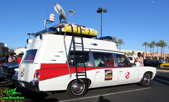 Photo of a red & white Pontiac Ambulance turned into ECTO-AZ the Arizona Ghostbusters Ectomobile at the Scottsdale Pavilions Classic Car Show in Arizona. Arizona Ghost Buster Ectomobile ECTO-AZ Ladder To The Ghostbusters Ecto Roof Rack