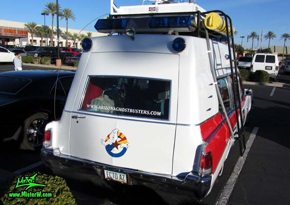 Photo of a red & white Pontiac Ambulance turned into ECTO-AZ the Arizona Ghostbusters Ectomobile at the Scottsdale Pavilions Classic Car Show in Arizona. Arizona Ghostbuster Ectomobile ECTO-AZ Tail Lights