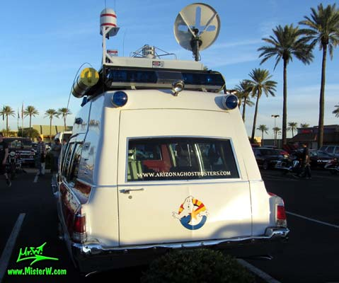 Photo of a red & white Pontiac Ambulance turned into ECTO-AZ the Arizona Ghostbusters Ectomobile at the Scottsdale Pavilions Classic Car Show in Arizona. Arizona Ghostbuster Ectomobile ECTO-AZ Rearview