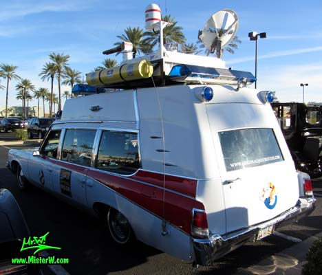 Photo of a red & white Pontiac Ambulance turned into ECTO-AZ the Arizona Ghostbusters Ectomobile at the Scottsdale Pavilions Classic Car Show in Arizona. Arizona Ghostbuster Ectomobile ECTO-AZ Back & Ecto Antenna