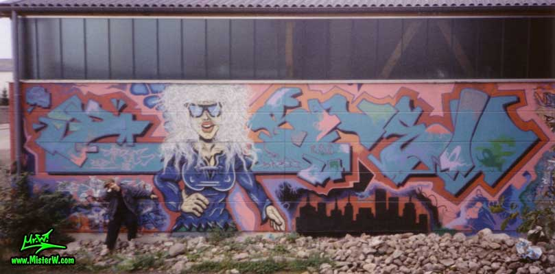 Vandalist in front of a Graffiti Painting - Pein & Pein Graffiti Hall of Fame. Double U, Character by B.Base
