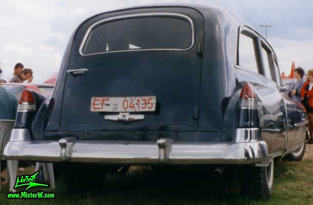 Photo of a black 1951 Cadillac Hearse at a classic car meeting in Germany. 51 Caddy Hearse Rearview