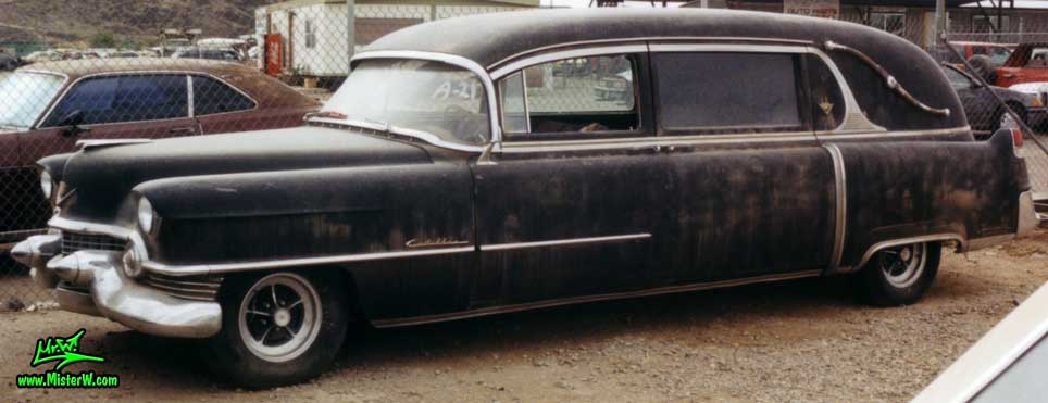 Photo of a black 1954 Cadillac Hearse at a junk yard in Phoenix, Arizona. 54 Caddy Hearse Frontview