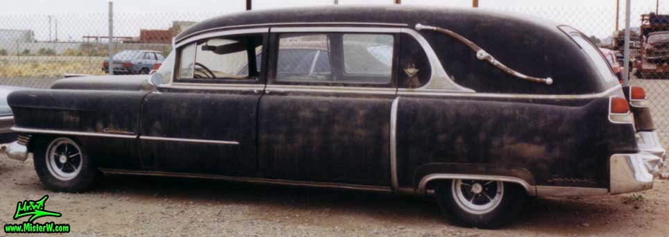 Photo of a black 1954 Cadillac Hearse at a junk yard in Phoenix, Arizona. 54 Caddy Hearse Sideview