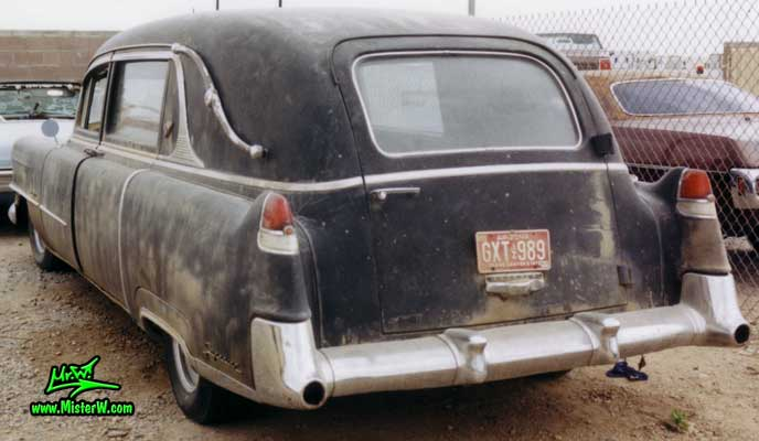 Photo of a black 1954 Cadillac Hearse at a junk yard in Phoenix, Arizona. 54 Caddy Hearse Rearview