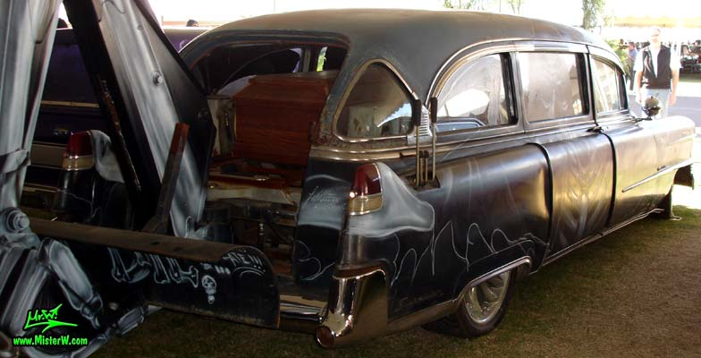 Photo of a black 1954 Cadillac Superior Funeral Coach at a classic car auction in Scottsdale, Arizona. Sideview of a 1954 Cadillac Superior