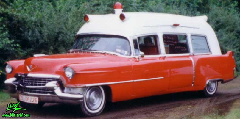 Photo of a red & white 1955 Cadillac Ambulance at a classic car meeting in Germany. 55 Caddy Ambulance Sideview