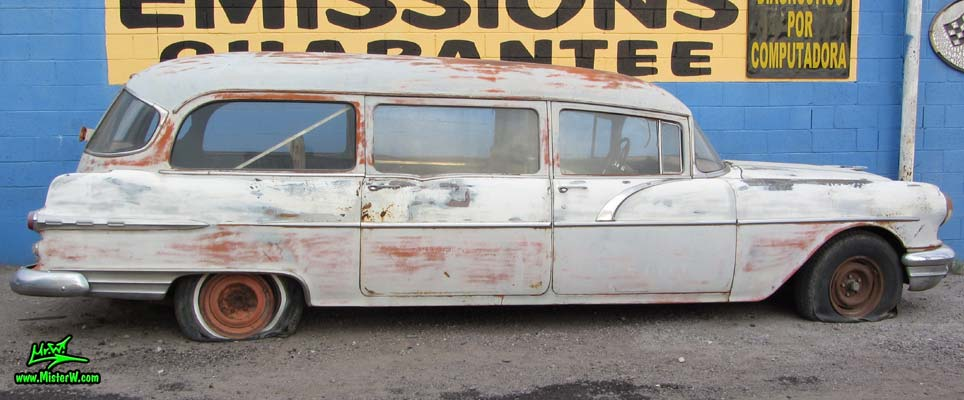 Photo of a faded grey 1956 Pontiac Memphian Ambulance in Phoenix, Arizona. Once painted red & white, in service for the Sheridan Willamina Fire Department in Oregon, build by the Memphian Coach Company in Memphis, Tennessee. 1956 Pontiac Memphian Ambulance Wagon