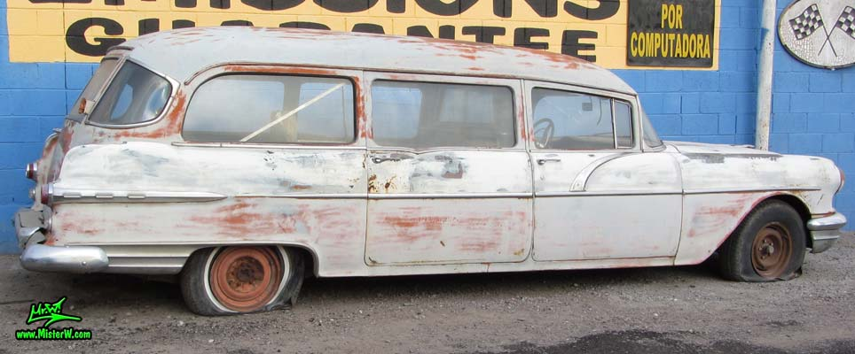 Photo of a faded grey 1956 Pontiac Memphian Ambulance in Phoenix, Arizona. Once painted red & white, in service for the Sheridan Willamina Fire Department in Oregon, build by the Memphian Coach Company in Memphis, Tennessee. Extra long 1956 Pontiac Memphian Ambulance