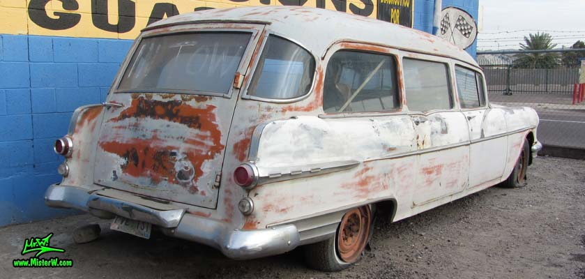 Photo of a faded grey 1956 Pontiac Memphian Ambulance in Phoenix, Arizona. Once painted red & white, in service for the Sheridan Willamina Fire Department in Oregon, build by the Memphian Coach Company in Memphis, Tennessee. Tail fins of a 1956 Pontiac Memphian Ambulance
