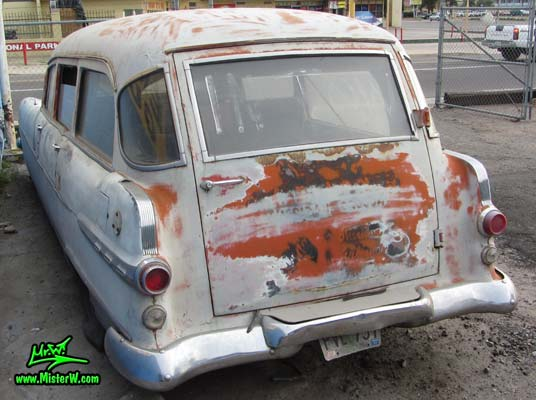 Photo of a faded grey 1956 Pontiac Memphian Ambulance in Phoenix, Arizona. Once painted red & white, in service for the Sheridan Willamina Fire Department in Oregon, build by the Memphian Coach Company in Memphis, Tennessee. Back of a 1956 Pontiac Memphian Ambulance