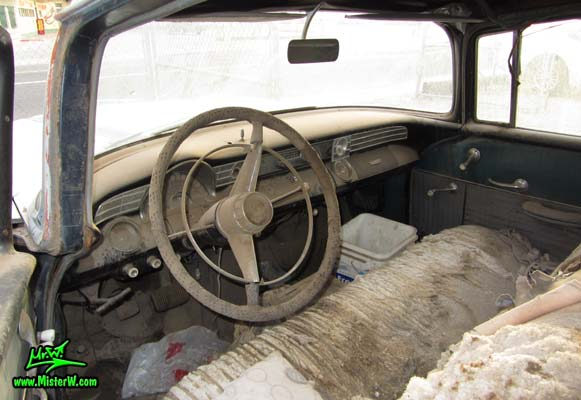 Photo of a faded grey 1956 Pontiac Memphian Ambulance in Phoenix, Arizona. Once painted red & white, in service for the Sheridan Willamina Fire Department in Oregon, build by the Memphian Coach Company in Memphis, Tennessee. Dashboard of a 1956 Pontiac Memphian Ambulance