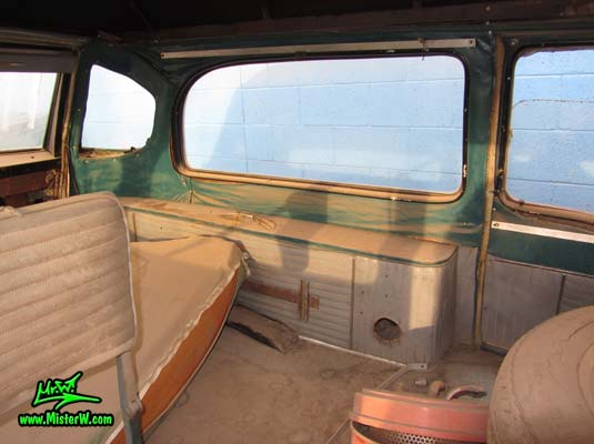Photo of a faded grey 1956 Pontiac Memphian Ambulance in Phoenix, Arizona. Once painted red & white, in service for the Sheridan Willamina Fire Department in Oregon, build by the Memphian Coach Company in Memphis, Tennessee. Back interior of a 1956 Pontiac Memphian Ambulance