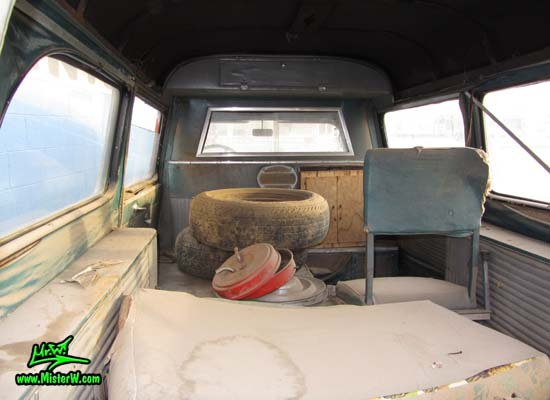 Photo of a faded grey 1956 Pontiac Memphian Ambulance in Phoenix, Arizona. Once painted red & white, in service for the Sheridan Willamina Fire Department in Oregon, build by the Memphian Coach Company in Memphis, Tennessee. Rear interior of a 1956 Pontiac Memphian Ambulance