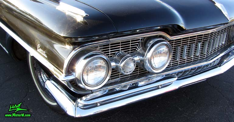 Photo of a black 1959 Oldsmobile Comet Hearse at the Scottsdale Pavilions Classic Car Show in Arizona. 59 Oldsmobile Comet Hearse Head Lights