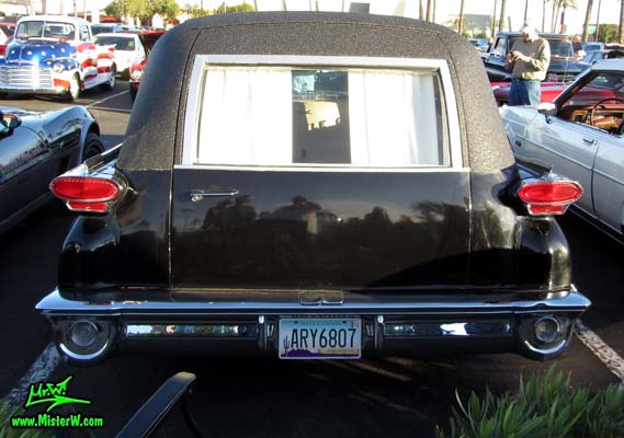 Photo of a black 1959 Oldsmobile Comet Hearse at the Scottsdale Pavilions Classic Car Show in Arizona. 59 Oldsmobile Comet Hearse Rearview