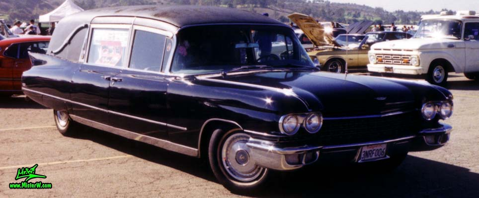 Photo of a black 1960 Cadillac Hearse at the Pomona Classic Car Swap Meet in Los Angeles, California. 60 Caddy Hearse Fronview