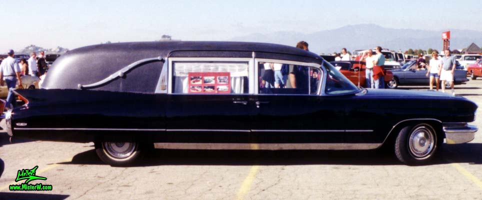 Photo of a black 1960 Cadillac Hearse at the Pomona Classic Car Swap Meet in Los Angeles, California. 60 Caddy Hearse Sideview