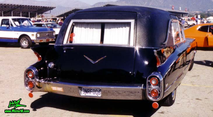 Photo of a black 1960 Cadillac Hearse at the Pomona Classic Car Swap Meet in Los Angeles, California. 60 Caddy Hearse Rearview