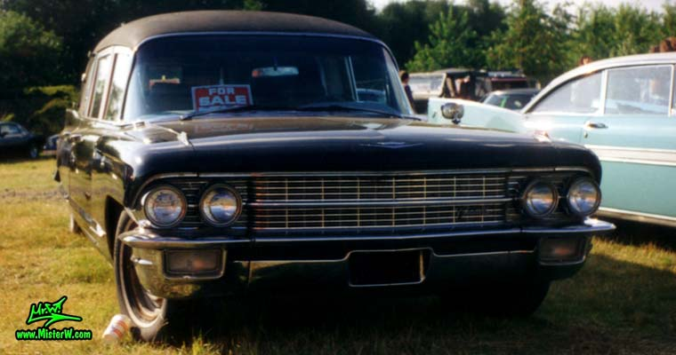 Photo of a black 1962 Cadillac Hearse at a classic car meeting in Germany. Front of a 62 Cadillac Hearse