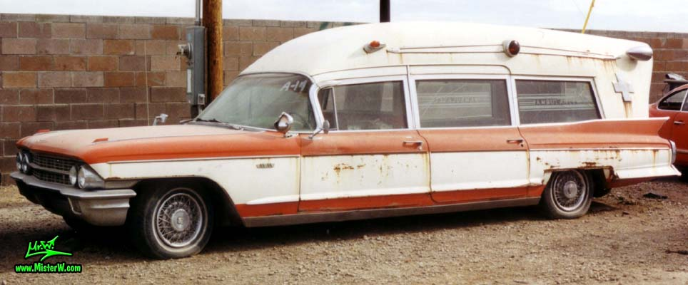 Photo of a red & white 1962 Cadillac Ambulance at a Junkyard in Arizona. 62 Caddy Ambulance